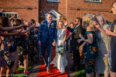 Throwing confetti  Confetti shot The Barns Hotel Cannock West Midlands Wedding Photographer