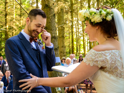 Bride and groom exchanging wedding vows during woodland wedding ceremony  West Midlands Wedding Photographer