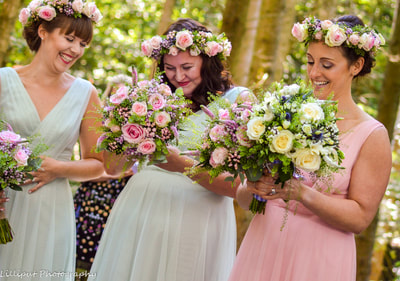 Bridesmaids laughing during woodland wedding ceremony in the forest  West Midlands Wedding Photographer