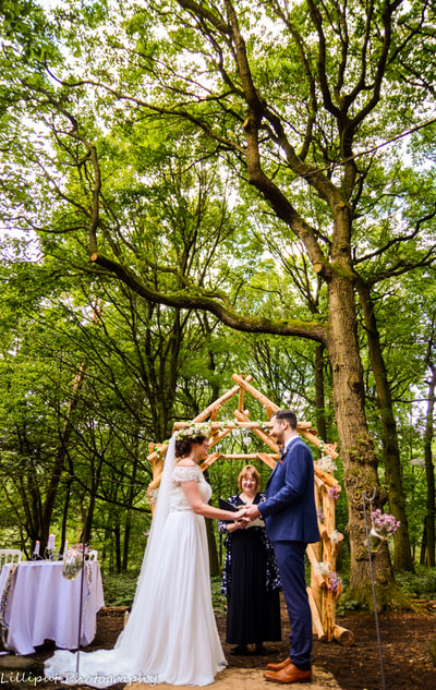 Bride and groom exchanging wedding vows during wedding ceremony  West Midlands Wedding Photographer