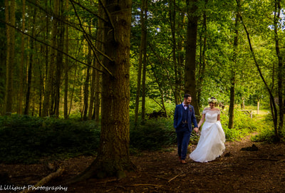 bride and groom walking in the woods during bridal portraits, by Lilliput Photography, West Midlands Wedding Photographer  Woodland wedding