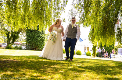 Bride and groom walking in the grounds of their wedding venue in Shropshire, by Lilliput Photography, West Midlands Wedding Photographer