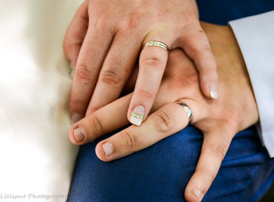 Wedding Rings on Bride and Groom's hands, by Lilliput Photography, West Midlands Wedding Photographer