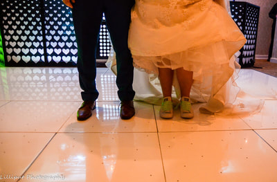 Bride and groom take their first dance, by Lilliput Photography, West Midlands Wedding Photographer