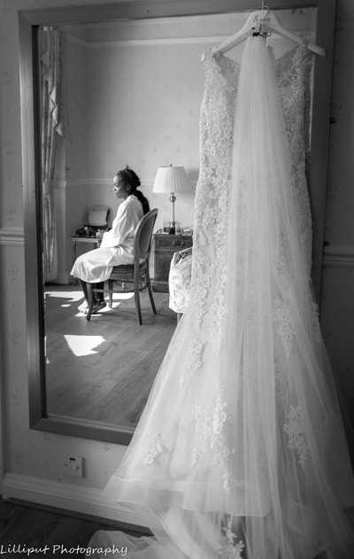 Bride takes a moment of contemplation, before her wedding ceremony, by Lilliput Photography, West Midlands Wedding Photographer
