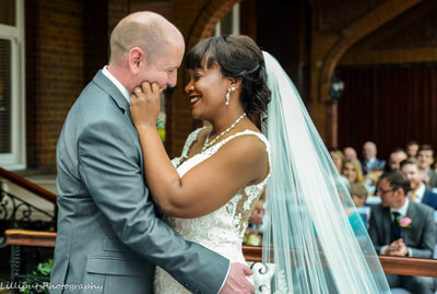Bride and groom share a tender moment during wedding ceremony, by Lilliput Photography, West Midlands Wedding Photographer